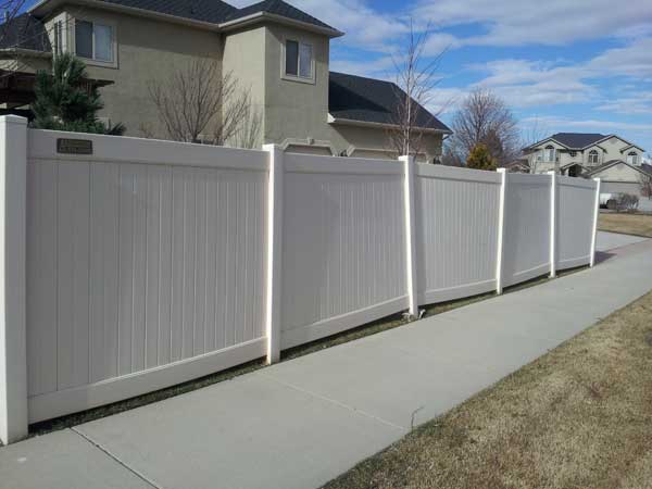 leaning vinyl fence